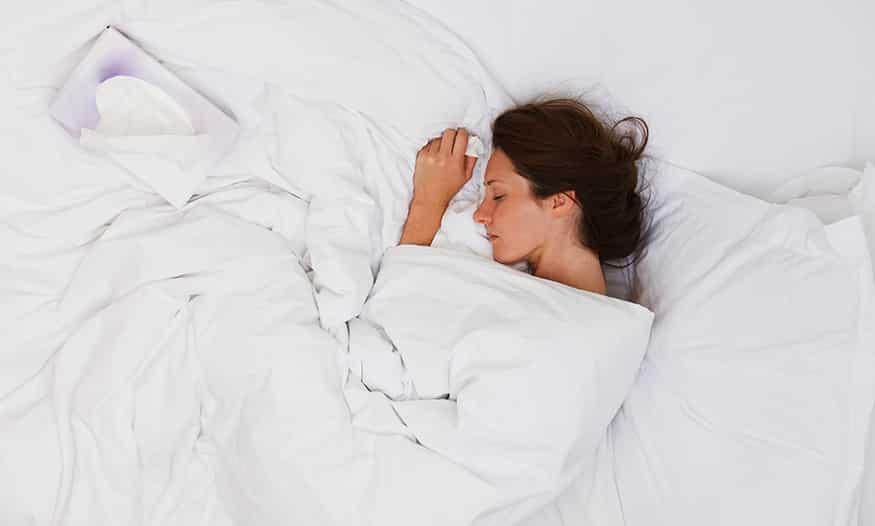 mujer triste cama pañuelos embarazo ectópico